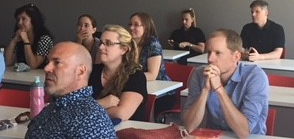 This image shows uOttawa employees in a meeting in a classroom