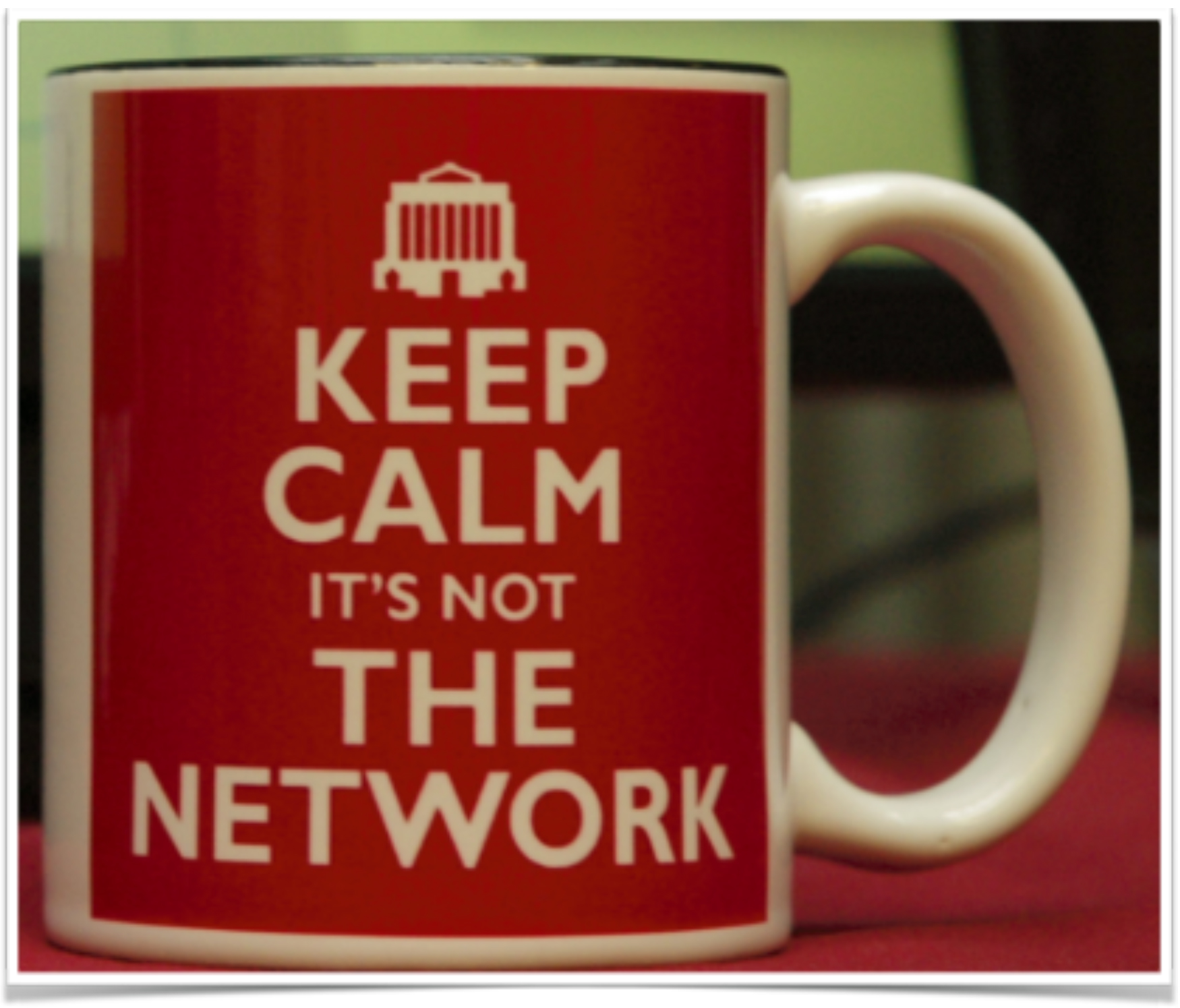 A coffee mug that reads keep calm it's not the network.