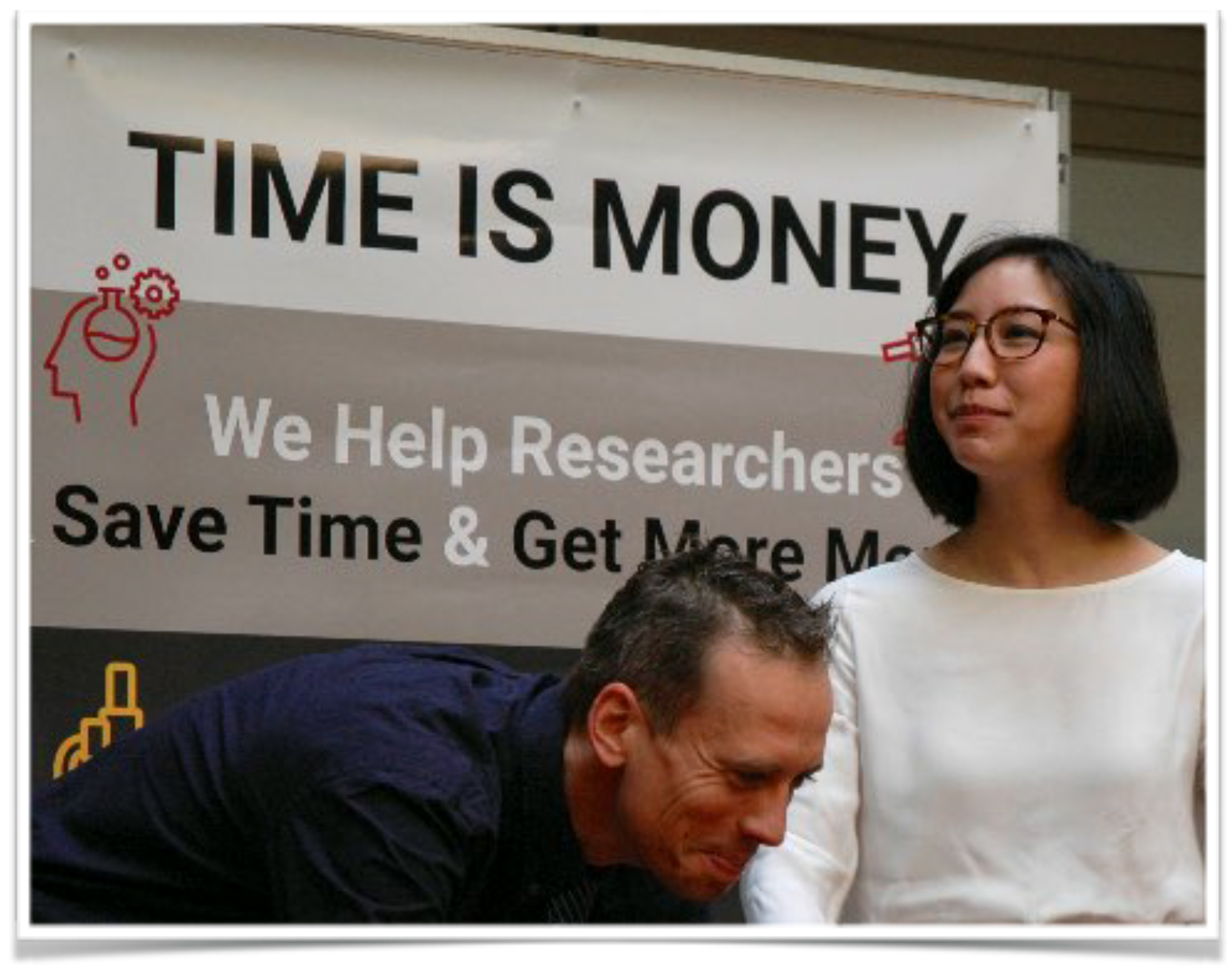 Employees presenting a poster with the title time is money.