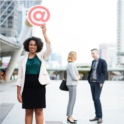 Women holding @ sign for email.