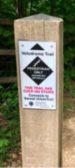 This image shows a sign indicating the beginning of a trail
